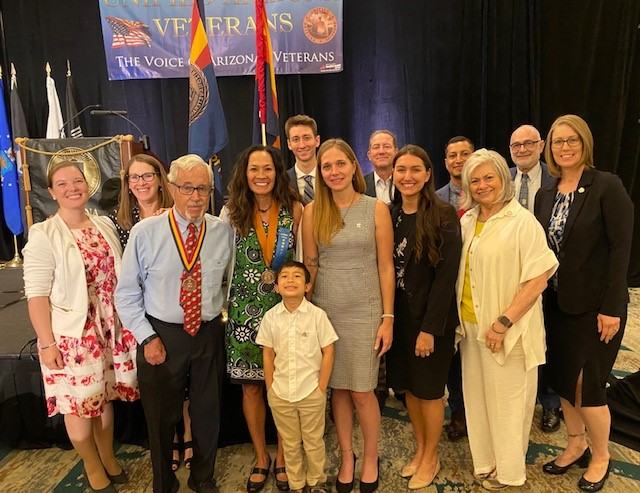 Kristine Huskey surrounded with current and former students, professors and family after receiving award