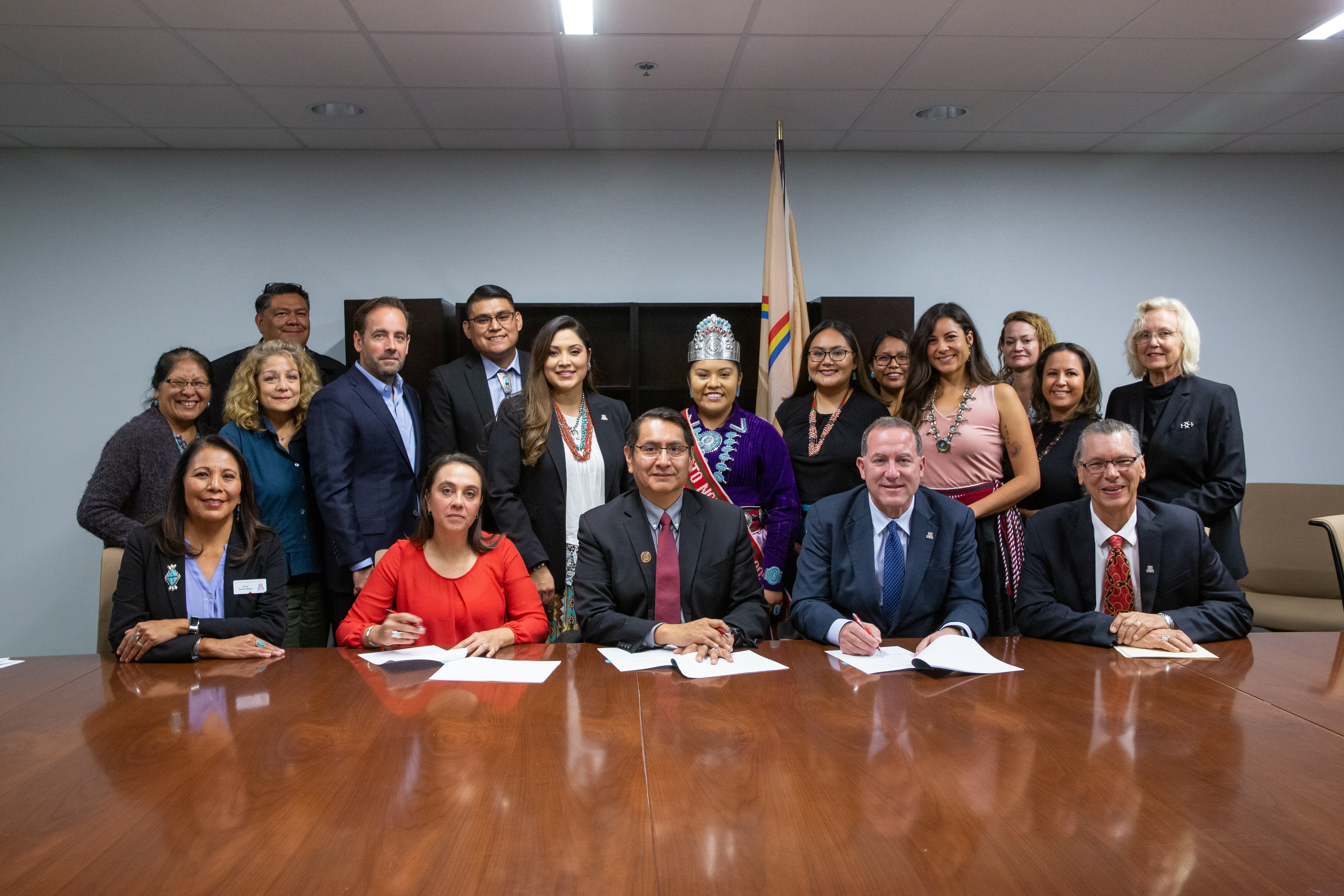 Representatives from the University of Arizona and the Navajo Nation gathered in a group to sign a memorandum of agreement establishing a new fellowship program