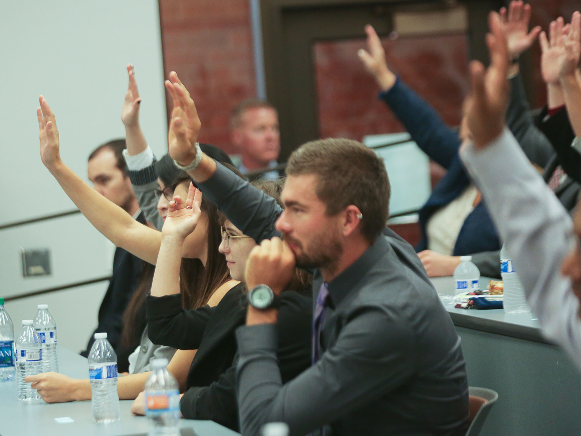 University of Arizona Law students raise their hands during a class