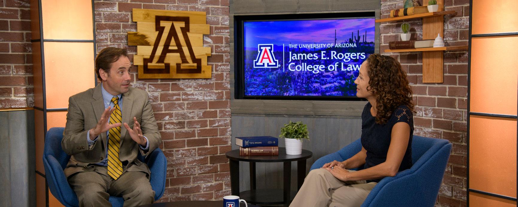 University of Arizona Law professors Christopher Robertson and Stacy Butler talking on a studio set