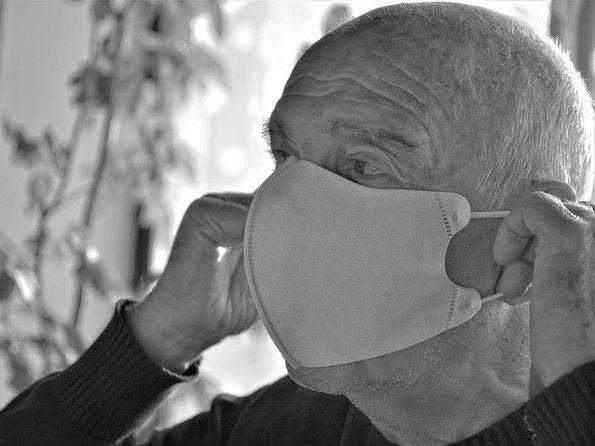 elder man wearing a mask