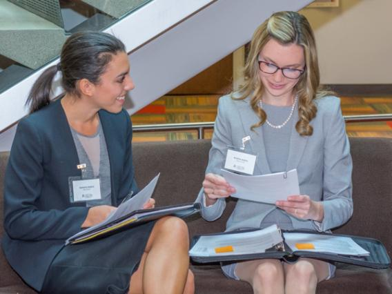 Two female University of Arizona Law students talk during the Sonoran Desert Career Fair