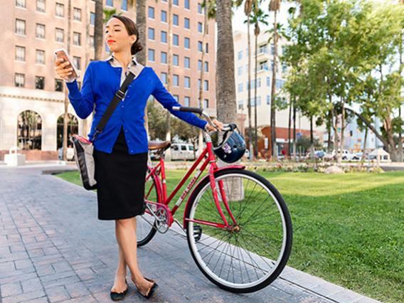 Woman with bike and cell phone