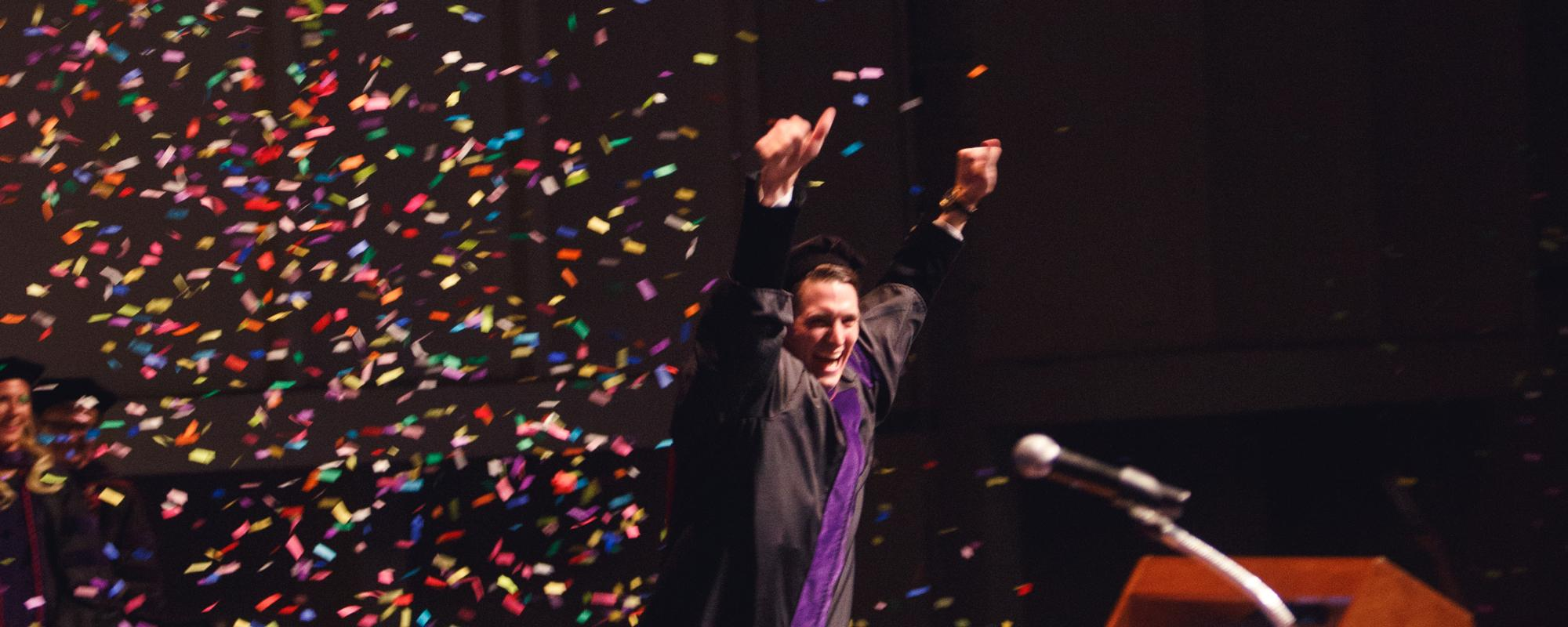 University of Arizona Law JD graduate celebrating with confetti