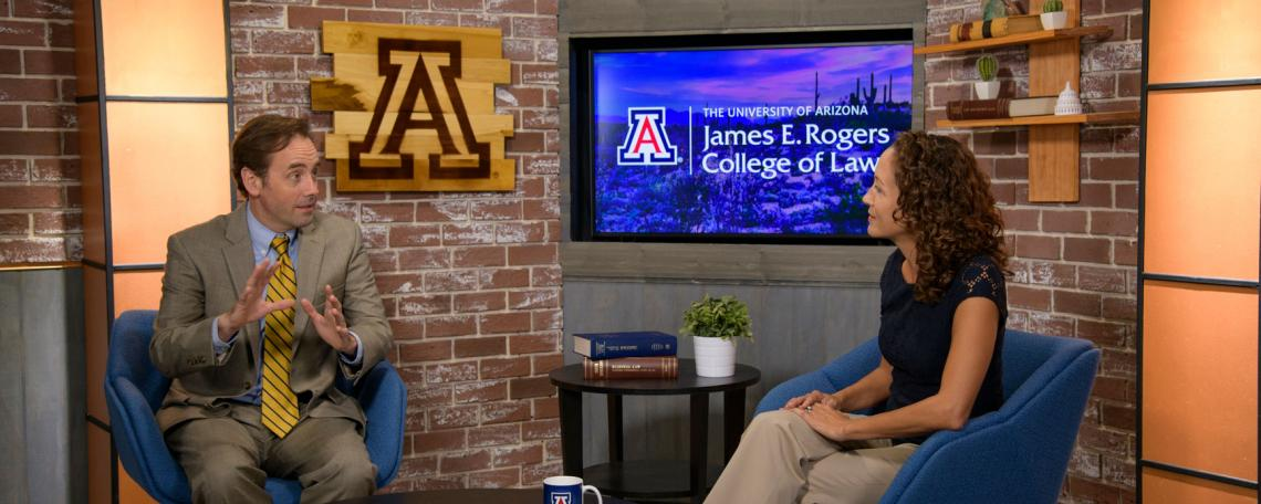 University of Arizona Law professors Christopher Robertson and Stacy Butler talking on a studio set