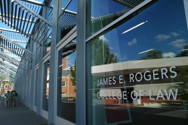 James E. Rogers College of Law sign on the glass window of the exterior of the University of Arizona Law building