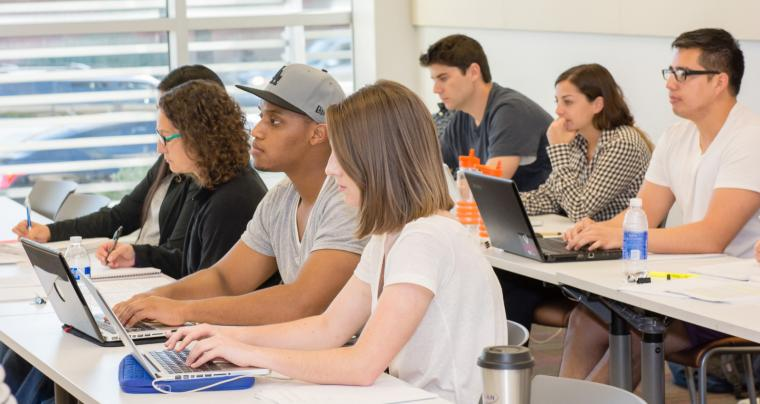 University of Arizona Law students work on laptops in a classroom