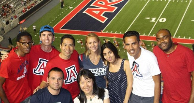International students in University of Arizona Law's JD for Non-U.S. Lawyers program at a University of Arizona football game