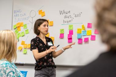 Arizona Law student speaking at workshop in front of whiteboard