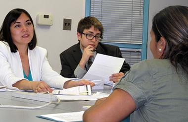 Law students consult with an immigration law clinic client