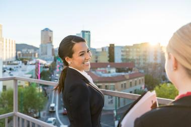 University of Arizona Law graduate smiling on balcony at work
