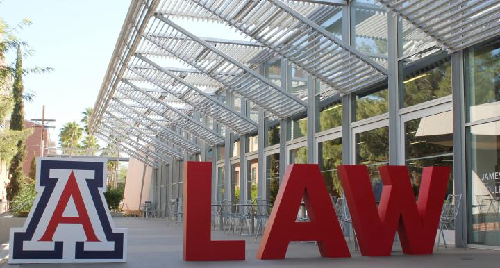 """University of Arizona Law courtyard with large red sign that spells out """"Law"""""""