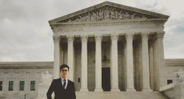 "The Slants founder Simon Tam in front of the U.S. Supreme Court. <em>Image via <a href=""https://www.instagram.com/slantsofficial/"" target=""_blank"">The Slants/Instagram</a>.</em>"