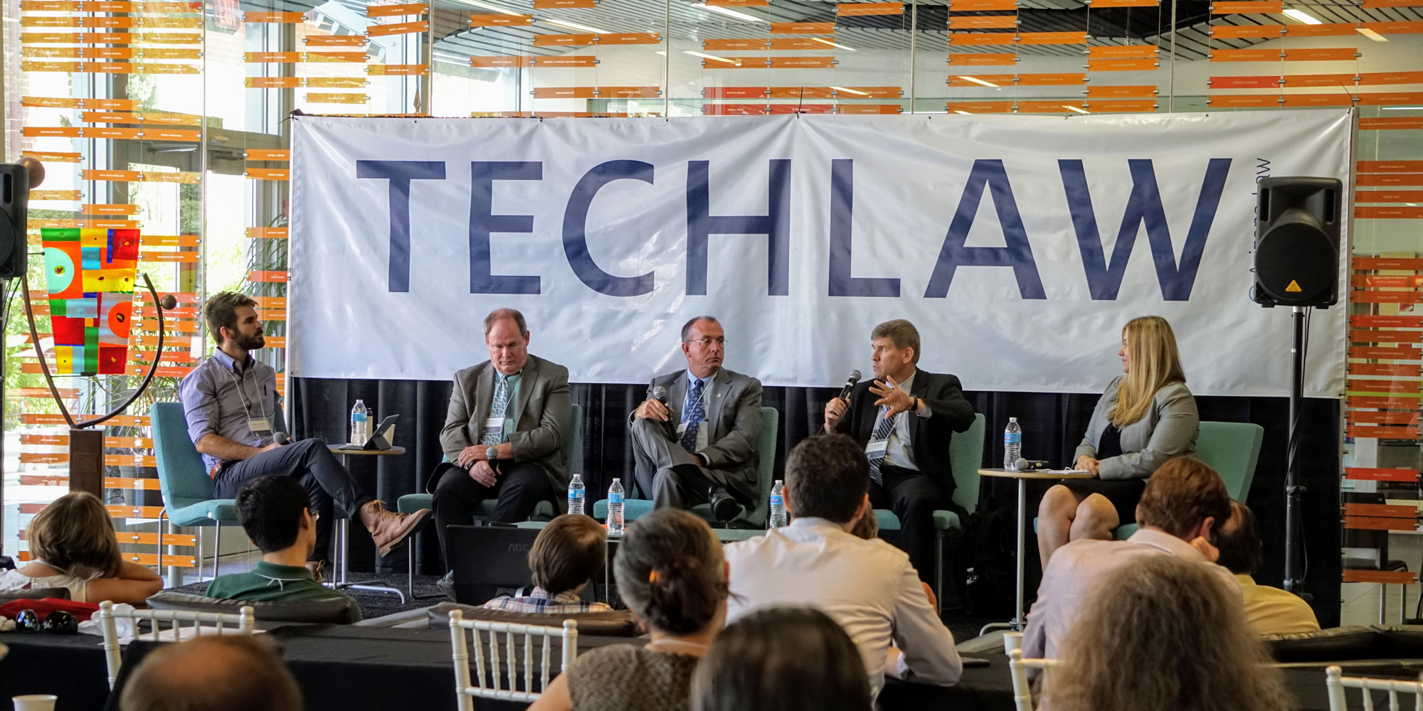Panelists on stage at the University of Arizona Law TechLaw Conference